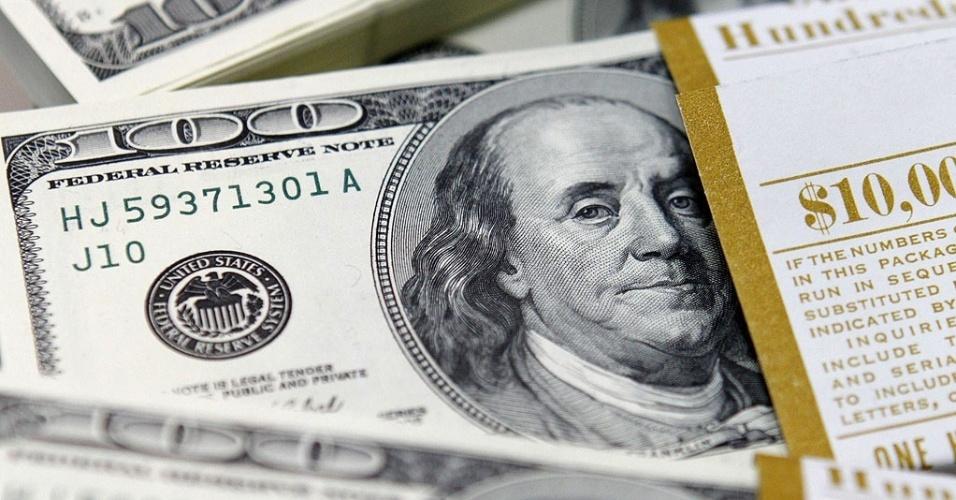 Mídia Indoor; wap; TV; dólar; dolares; nota; cédula; dinheiro; moeda; americana; EUA; Estados Unidos; troca; câmbio; mercado; cotação; exportação; importação; viagem; bolsa; valores; investimento; estrangeiro; capital